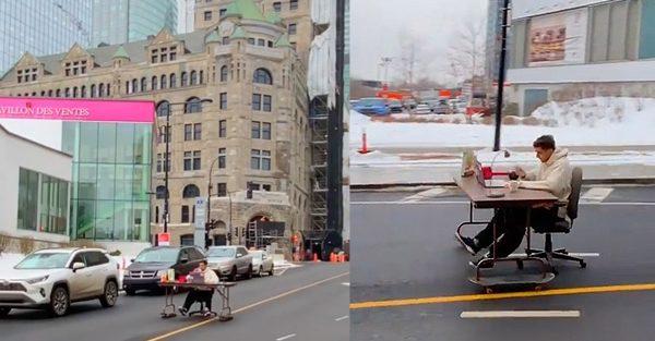 Il fait du télétravail en descendant la rue Peel à Montréal